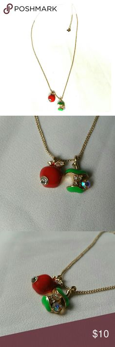 """Red & Green Apples Delicate Charm Necklace NWOT New without tags, never worn, red and green enameled apples with clear and aurora borealis crystal rhinestones on a delicate gold metal chain with lobster clasp closure and an extension chain with a petite butterfly dangling from it. Open length is 15.5"""" plus 2"""" extension chain. Apples 3/8"""".  Thank you for checking out my closet, and happy poshing!! :)   SORRY, NO TRADES OR OFF SITE SALES.   I DISCOUNT ON BUNDLES :) MDY Jewelry Necklaces"""