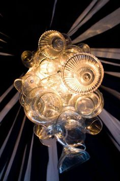 How cool is this chandelier? It was made from glass containers from thrift stores