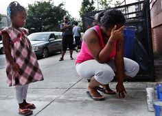 A woman grieving for her brother and cousin in Brooklyn, New York | The 45 Most Powerful Photos Of 2012