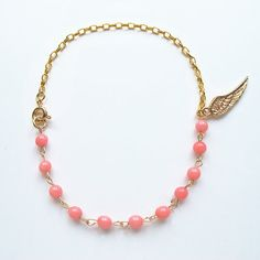 Natural pink coral, candy color gemstone bracelet with 24 K gold plated wing charm, multi-color available, FREE shipping #christmas #xmas #halloween #highquality #affordable #freeshipping #bead #beads #gem #gems #gemstone #gemstones #jewelry #jewellery #jewelrymaking #jewelrysupplies #jewelrysupply #etsy #farragem #design #designer #handcrafted #handmade #ring #necklace #earrings #bracelet #pendant Ring Necklace, Beaded Necklace, Earrings, Gemstone Bracelets, Candy Colors, Xmas, Christmas, Jewelry Supplies, Wings