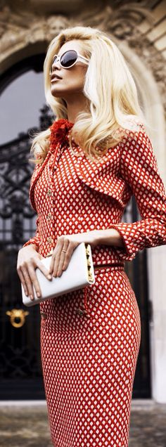 White round sunglasses, red and white print retro inspired jacket and pencil skirt, and white clutch