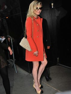 Love that papaya colored coat! and I love how she styled the rest of her outfit, great choice of pumps and purse