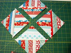 Rebecca this is so cool, you need to check out this speedy way to make pinwheels....  Aren't they pretty?! And then a few weeks ago I was watching some quilting tutorials on You Tube and remembered this video of a method of making half-square triangles, and I knew it would work to make these scrappy versions, too. This is what I did: