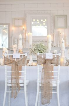 Sheer burlap bows look amazing on white chiavari chairs  white wedding deor. Source: Pocketful of Dreams. #weddingchairdecor  #burlap #diy