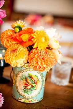 Orange Flowers in Antique Cup