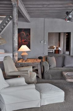 justthedesign: Living Room Interior Design By Axel Vervoordt. Block plaster and rustic wood furniture. Gray Interior, Interior Design Living Room, Interior And Exterior, Lounges, Rustic Interiors, Home And Living, Interior Inspiration, Living Spaces, Living Area