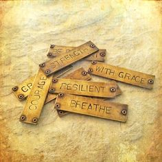 Affirmation pendants. I love the look and the idea but I have to admit that I wish they were grammatically parallel!