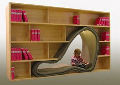 Everyone loves the idea of curling up with a book – but how about within a bookcase? The Cave is a combination bookcase and lounge chair design that provides a comfortable, cozy and visually secluded place to wrap yourself in your favorite volume and read for a while with a soft overhead light.  For children, the bookcase chair provides a nifty crawl space and it can even be a pet retreat. Placed against the wall it becomes a cozy nook and put in the center of a room it becomes a spatial…