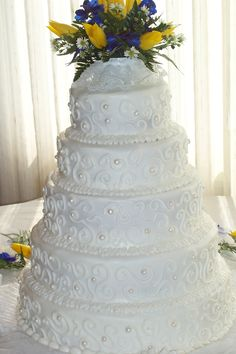 White on white wedding cake. I would take off the flowers and add a simple, elegant cake topper