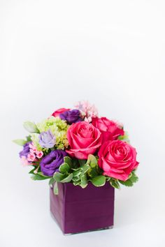 Kiko Roses, bold bouvardia, and mini hydrangea create an exquisite arrangement rich with pink and purple jewel tones. From Helen Olivia Flowers via Bloompop