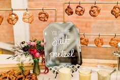 Cute soft pretzel display for cocktail hour. Salty soft pretzels with honey mustard and beer cheese adorn a delightful…