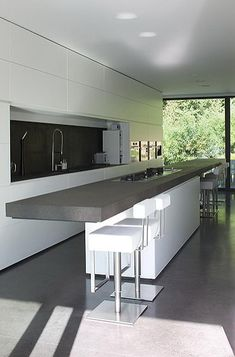 Minimalist kitchen inside the Perke House by Atelier d'Architecture Bruno Erpicum & Partners ( © Jo Pauwels) _