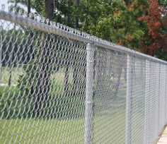 Chain Link And Barb Wire On Top Three Strands Www