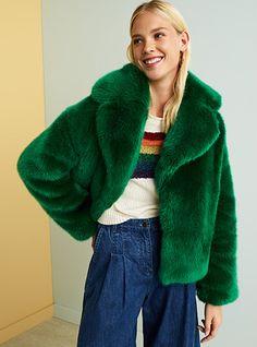 green furry coat, rainbow knit, and culotte denim