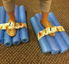 """Items needed: pool noodles, hot glue gun, duct tape. Cut the pool noodles about 12""""-14"""". Glue four together with hot glue gun. Make several passes with hot glue to insure that the noodles adhere very well. Cut a piece of duct tape the width of the snowshoe. Lay it sticky side up across the shoe.…"""