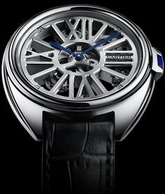 #MensStyle #Watches Clé de Cartier Squelette Automatique Watch. Cartier's is distinct and consistent in its approach to skeleton watches, and this watch is no different, reflecting the signature Cartier skeleton design traits set inside a 41mm palladium Clé case.