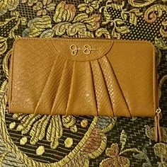 """NWOT! Jessica Simpson Brown """"Emmy"""" Wallet NEW WITHOUT TAGS!! Jessica Simpson Brown """"Emmy"""" Wallet! Can hold 8 cards. Zippered inside pocket. Large enough to hold my Sony Xperia Z3V phone, which is a little bigger than the iPhone 6. Has a place where you can attach a strap to turn into a wristlet. Measures 8"""" x 4.25"""" and almost 1"""" thick when zipped shut.  10% off when bundled with another listing!!! Jessica Simpson Bags Wallets"""