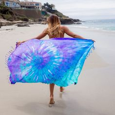 """SAND CLOUD DONATES 10% OF NET PROFITS TO PRESERVE MARINE LIFE. This Luna Tie Dye Beach Towel will be the grooviest towel at any beach, festival, or park. This towel is the definition of """"Peace, Love,"""