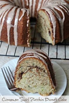 Cinnamon Swirl Zucchini Bundt Cake - Moist Zucchini cake with a cinnamon swirl and cinnamon glaze! via www.julieseatsandtreats.com