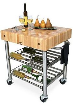 Ideal for wine and cheese parties, the John Boos Wine Cart holds up to twenty-four bottles of your favorite wine and boasts a sturdy butcher block for presentation and prep.