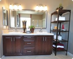 I really like the look of framed mirrors. Easy enough to pick a frame that matches the bathroom hardware.