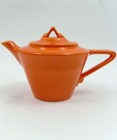 Homer Laughlin Pottery's Fiesta Harlequin teapot in original radioactive red glaze, art deco-influenced tapering body and angular triangle shape handle and knob, c. 1939-1943, USA ... colour name comes from the uranium oxide used in the glaze, whcih became unavailable for non-war use in the mid 1940s
