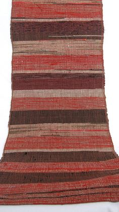 Sakiori is a traditional Japanese weaving technique using fabric strips and scraps. It lies in the tradition of mottainai (no waste) and is the product of hours of skilled home weaving. This obi is typical peasant clothing of Edo period until early Showa. This is estimated as Meiji, more than 100 years old. Made of hand loomed cotton.