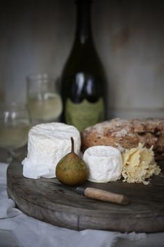 My favorite meal.  Crusty bread, cheeses, pears and champagne.