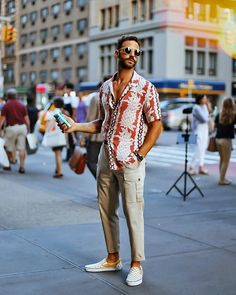 @bluecollarprep with a summer Hawaiian shirt with slip on racer check slip on loafter and tan cargo pants with sunglasses #menswear #summerfashion #summerstyle #summeroutfit #menstyle #vans #hawaiianshirt
