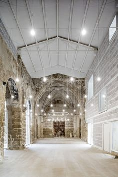 The Spanish firm preserves this small Gothic sacred space using a fitted white shell.