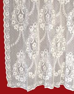 Rhona is a formal pattern that is very popular.  It is a Nottingham cotton lace panel imported from Scotland.  It starts at $88.95.