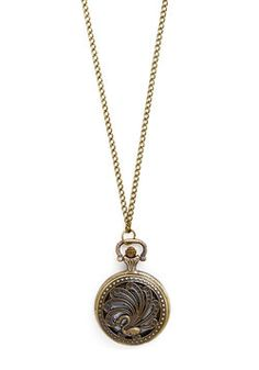Watch and Glisten Necklace in Fauna. Its time to dress down at work, but you still stick to your usual style and pick this pocket watch necklace out of your collection! #gold #modcloth