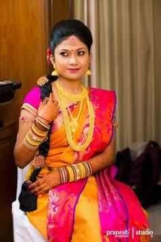 South Indian bride. Temple jewelry. Jhumkis.Orange silk kanchipuram sari.Braid with fresh jasmine flowers. Tamil bride. Telugu bride. Kannada bride. Hindu bride. Malayalee bride.Kerala bride.South Indian wedding