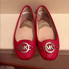 Michael Kors Fulton Flats, red, size 9 Lovely red authentic MK Fulton flats with silver MK logo.Shoe has been used with signs of wear at d bottom& back(pls check pics) but it's still in good condition.Offers r welcome.Its a loose size 9 fit as that's how the fultons are made. Michael Kors Shoes Flats & Loafers