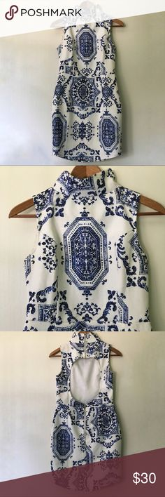 Selfie Leslie // High Neck Blue, White Print Dress Wow a crowd in this beautiful dress from Selfie Leslie. High neck, mock turtleneck. Open back. Fitted, body con shape. Exposed zipper on the back of the neck and skirt. Sold at forever 21. In excellent condition. Selfie Leslie Dresses Mini