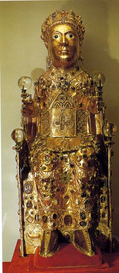 "Reliquary statue of Sainte Foi in Majesty, late 9th or 10th century w/later additions. Abbey Church of Saint Foi, Conques, France. Silver gilt over a wood core, with added gems and cameos of various dates. H 33"". The relic inside is the skull of the child martyr, Sainte Foi [Saint Faith]."