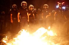 Riot police officers gather on June 10, 2013