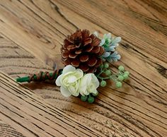 Silk Boutonniere - Pine Cone Rustic Winter Boutonierre. Rustic winter boutonniere for more than just weddings. This unique and memorable boutonniere features: Rustic Pine Cone Mint Beadspray Green-Grey Sage Filler Mini White Ranunculus Blossoms Custom Ribbon of your choice Ribbon can be customized according to your choice. For this boutonniere I personally recommend: organic brown twine, burlap twine. Wedding sets: Please contact me with any custom requests or bridal sets! For most sets...