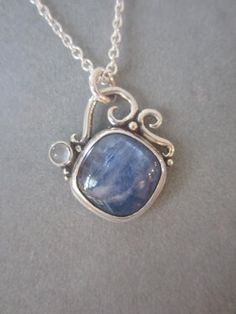 Sterling silver pendant with kyanite & moonstone. Handcrafted by Richelle Leigh Collection.