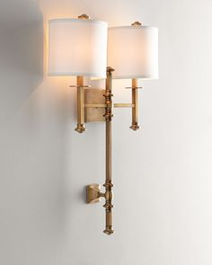 "Transitional two-light sconce. Made of metal. Warm brass finish. Fabric shades. Uses two 60-watt bulbs. Direct wire; professional installation required. 18.125""W x 5.5""D x 28.75""T. Imported. Weight, 7"