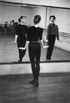 Audrey Hepburn working with dance instructor Lucien Legrande on one of the numbers for Funny Face (Stanley Donen, 1957)