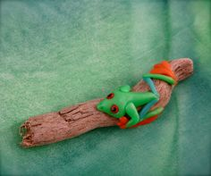 Polymer clay animals on driftwood