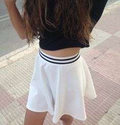 white skater skirt; the stripes make it look like a varsity skater skirt