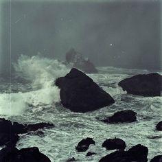 black beach white sea