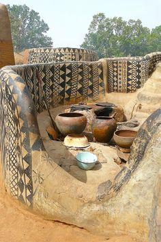 Burkina Faso - at the base of a hill overlooking the surrounding sun-drenched West African savannah lies an extraordinary village, a circular 1.2 hectare complex of intricately embellished earthen architecture.