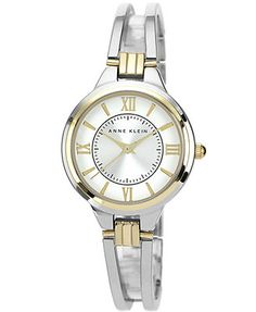 Slip on this polished bangle watch from Anne Klein and add instant fashion. | Silver-tone mixed metal bangle bracelet with gold-tone connectors | Round case, 28mm, gold-tone bezel | Silver-tone sunray