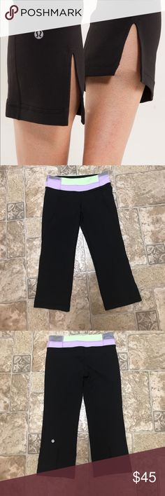 Lululemon Tadasana split crops Black with light purple/grey stripes/ neon yellow  waistband. Split at bottom back legs. Hidden pocket in waistband. Excellent, like new condition. lululemon athletica Pants Ankle & Cropped