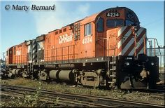 A pair of Canadian Pacific (CP Rail) C424s layover in Sudbury, Ontario on September 24, 1989.