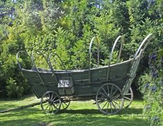 Old covered wagon.. I'd love to have this in our yard~