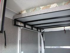 Happijack Power Bed Lift is easy to operate and will maximize space by lifiting up to two queen-size beds out of the way to make room for motorcycles or ATVs. Cargo Trailer Camper, Cargo Trailer Conversion, Sprinter Camper, Camper Van Conversion Diy, Truck Camper, Van Conversion Bed Lift, Van Conversion Bed Ideas, Mercedes Sprinter, Mercedes Benz